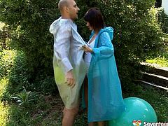 Two aroused folks cover their bodies with raincoats in order to hide from rain, however even this plastic wear doesn't stop them from fucking. Submissive dark haired hussy sits on a fit ball while giving thorough blowjob in peppering sex clip by Seventeen Video.