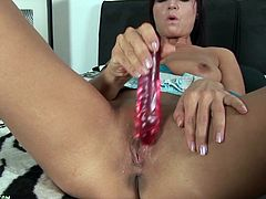 An amazing solo video featuring a hot brunette hottie as she gets naked for the camera and sticks a hard toy in her wet pussy.