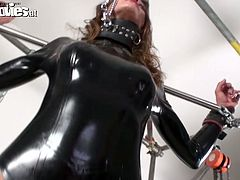 Two hawt brunet seductresses in latex sextractive costumes whip one chained bitch. They are eager to lick her pussy and make her orgasm.