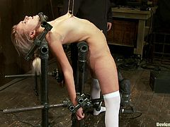 See how this blonde with small tits gets her nipples tortured and her shaved snatch toyed while she's in a very uncomfortable position in this bondage clip.