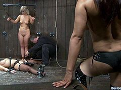 The two submissive blondes are having their pussies toyed while they are going through some kinky bondage situations and are dominated by Isis Love.
