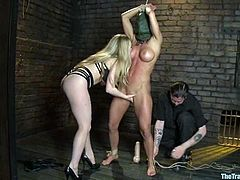 Hot brown-haired girl gets tied up by blonde girl. Later on she gets her pussy toyed deep. She also gets face fucked with a strap-on.
