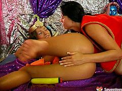 Two lustful brunette babes are role playing wearing seductive Egyptian costumes. They poke each other's delicious shaved pussies with dildo in steamy sex video by Seveteen Video.