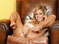 Nicole Graves with massive jugs and hairless cunt spreads her legs to fuck herself with sex toy