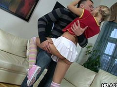 This blonde cheerleader has a lolly, but she would rather be sucking on a nice thick cock. She shows off her cute panties and shoes and then kisses her football player boyfriend. She deepthroats his massive penis and then rides him like wild.