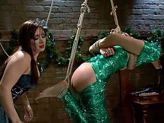 Everything's fantastic as long as she's wrapped in plastic! This mistress has some very special ways to unwrap her presents and we love to see her in action. She hangs that slut and spanks her ass really hard, but the cunt can't even beg for mercy as she is ball gagged. Things are getting more and more interesting!