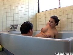 Busty Japanese hottie Mio Takahashi is having fun with some guy in the bathroom. She lets him rub her big natural tits and cute pussy and then drives him crazy with a titjob.