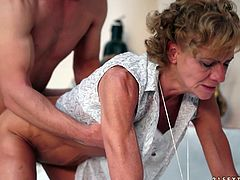 Salacious blonde grandma and a young man make out and caress each other. Then the granny shows her cock-sucking abilities and they have sex in missionary and other positions.