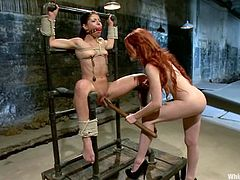 The redhead Elle Alexandra is going to dominate Mia Gold in this video where she ties her up, toys her pussy and fucks her with her strapon.