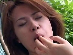 This brown haired Japanese lesbian is tied up by her mistress. The mistress kisses her hard and then makes her suck her tits. The mistress stick her fingers in the slave's mouth and then fingers her hairy vagina while kissing her.