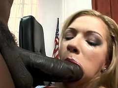 Bibi Noel is a gorgeous blonde babe. She struggles to get a huge black cock down her throat and she succeeds.