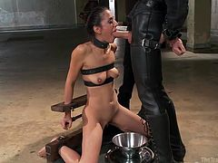 Lyla is in Owen's sex dungeon and he ties her up with belts and ropes. He then makes her balance two heavy plates in each hand. Once her arms give out and she can't take it anymore, he sticks his dick in her opened mouth, and makes her deep throat it. She gags on his cock and coughs up spit and precum.
