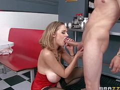 Katie Kox is one super sexy buxom milf in barely there red dress and black stockings. She shows her massive melons to lucky guy and sucks his dick. He needs titjob badly. Busty Katie Kox is good at it.