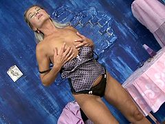 A blonde milf gets naked and performs a hot solo scene where she gets naked and fingers her wet pink gash, check it out right here!
