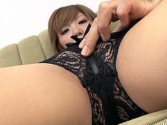 Playful Japanese amateur in lacy black lingerie lies on the couch in front of aroused wanker who exlpores her cuddly body by pinching her brown nipples and later tickling her hairy pussy with vibrator in POV sex clip by Jav HD.