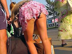 Hot blonde poses her sexy panties in amazing upskirt public session