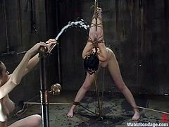 What a severe BDSM this is. Honey chick Trixie Kitten loves being tied up and tortured. But this time she gets surprised by the way she gets a clod stream of water.