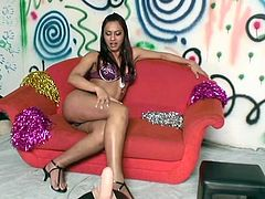 Brunette Shemale riding sibian in solo as she jerks her thick cock to entice us with her show before the camera.
