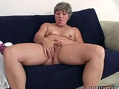 Dirty granny Magdolina is perverted mature slut. She is sitting naked on a couch exposing her fluffy body. Magdolina spreads her legs letting the guy insert big dildo into her clam poking it actively. Hot 21 Sextury video of old mommy getting toy fucked on cam.