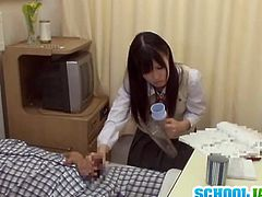 Kinky asian takes sick man's cock and starts stroking it to make him feel better. Old guy gets so horny that he can't help to fuck her hairy pussy.
