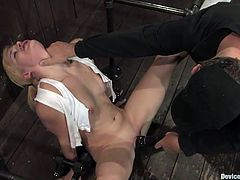 A gorgeous blonde bitch with pigtails gets restrained with bondage devices and has her pussy rubbed with a vibrator! Check it out!