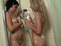 These two kinky cuties are having a good time in the shower sticking a dildo in their asses.