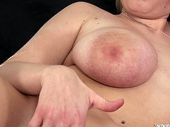 Look at her! She is just a gorgeou wet dream of horny guys. Busty and lovely blondie named Tiana is masturbating in bed with a plastic toy.