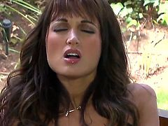 Pretty brunette babe Roxanne Milana with tight firm ass and perfectly shaped hooters in black boots only polishes her shaved cunny to wet orgasm in provocative position in backyard.
