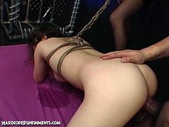 Watch a provocative Japanese brunette slave getting tied up in the dungeon. Then she's ready to let her master bang and dildo her trimmed clam into a viciously intense orgasm.