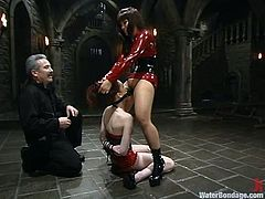 Justine Joli stands on her knees getting face fucked with the strap-on by DragonLily. Later on she gets her pussy stuffed from behind. After that she gets tortured in water.