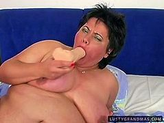 Hot tempered brunette fat momma tries to satisfy her insatiable pussy in solo. She thrusts dildo between her fat pussy lips and fucks it intensively.