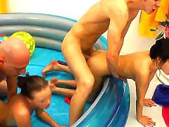 Young slender sluts Lili Lamour and Mary Lee with natural boobs and long legs gets oiled and fucked in the asses by randy studs Omar Galanti and Markus A in rough foursome.