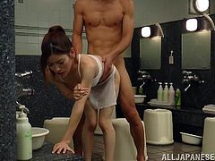Slim and hot Japanese babe washes a guy in the bathroom and then gets fucked in her wet vagina. Later on she also sucks a dick standing on her knees.