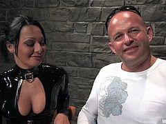 The hot Sandra Romain is in a sexy latex outfit for today's femdom session with a big guy about to be strapon fucked by a girl.