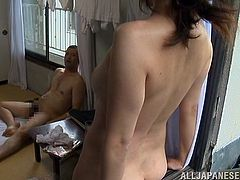 A chubby dude is going to have hot sex with his Japanese wife after he came back home. They enjoy the missionary sex before he cums on her thighs.