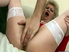 Ugly mature woman is finger fucked in her clam having butt plug in dirty porn movie