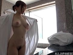 Slim Japanese girl take a morning shower. She pours water on her sexy body and in washes herself in a sexy way.