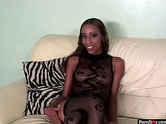 Jaw dropping black babe in steamy sheer black lingerie and stockings strips in front of rapacious dude before she lies on her back with legs wide open to boast with her shaved tasty vagina, which she later gets tongue fucked in peppering sex video by Pornstar.