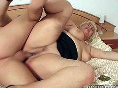 Chubby mature blonde gives her young sex partner tits job and blowjob. Later she gets cozy and he finger fucks her fat pussy.