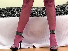 Juggy blond bombshell in raunchy pink fishnet tank, stockings and panties poses seductively in front of cam before she takes a huge baseball batt to pound her gaped moist vagina in sizzling hot solo sex video by 21 Sextury.