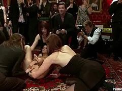 Maitresse Madeline and Princess Donna Dolore are having some good time in a public disgrace scene. They get pubished by a group of people and then give a blowjob to some guy.