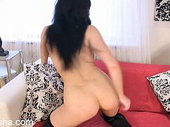 Check out this very sensual brunette in provocative lingerie as she plays with her pink pussy in this solo video.