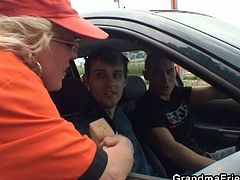This mature whore works at a gas station. These two young guys picked her up and fucked her holes in an open field.