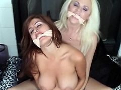 Bound fetish Model Sasha Monet inside lesbo slavery and strict restraints round fellow submissive