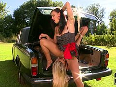 Sexy blonde babe was carried to this place in a truck. She has got her hands and legs tied up with rope. Brunette mistress licks blonde's wet pussy while the latter is still lying in a truck. Later tough mistress is facesitting her hostage.