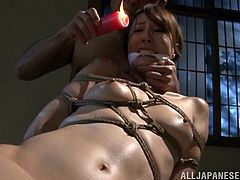 Reiko Sawamura is turned on by Shibari and candle wax torture. Her dominant master ties her up in rope and pours hot candle wax, dripping it on to her beautiful naked body. She is gagged and her nipples take a lot of torture.