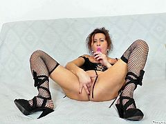 Hussy Czech slut is ready to show you her stretched hell working pussy. She spreads her fishnet stocking legs wide and dildo fucks her shaved muff.