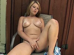 A gorgeous big titty blonde cups her tits while she fingers her moist pink pussy in this hot solo video, check it out right here!