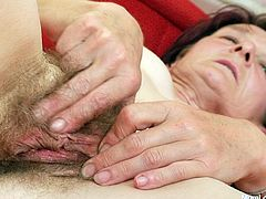 Czech milf is eager for orgasm and uses dildo fellow to satisfy her insatiable hairy pussy. She spreads her legs wide and thrust toy between worn out pussy curtains. Enjoy kinky momma for free.