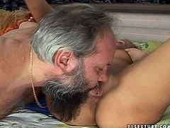 Luscious blond whore lies on her back with legs wide open getting her cunt fingered and eaten by horny grey haired dad before she clings to his stiff cock to give a blowjob.